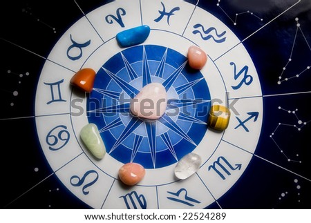 healing stones on an astrological wheel - stock photo