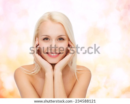 health and beauty concept - beautiful woman touching her face skin