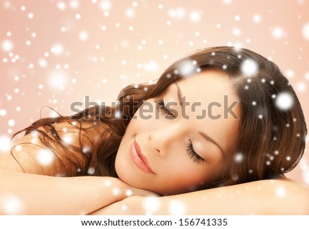 health and beauty concept - beautiful woman with long eyelashes in spa - stock photo