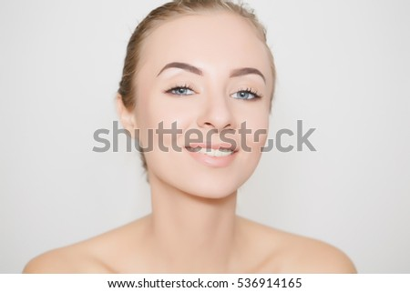 Health and beauty concept - beautiful young woman face on white with vivid shadow