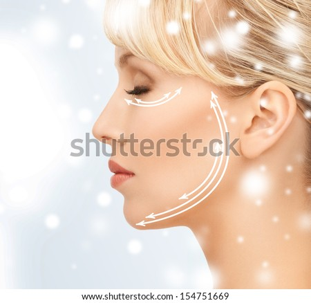 health and beauty concept - beautiful young woman face with arrows - stock photo