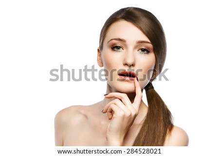Health and beauty concept - clean face of beautiful young woman touching her mouth her finger - stock photo