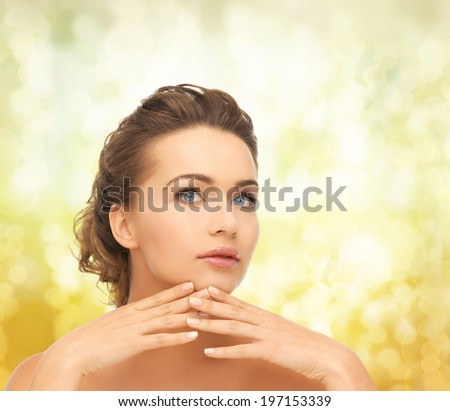 health and beauty concept - face and hands of beautiful woman with updo, can be used as a template for jewelry - stock photo