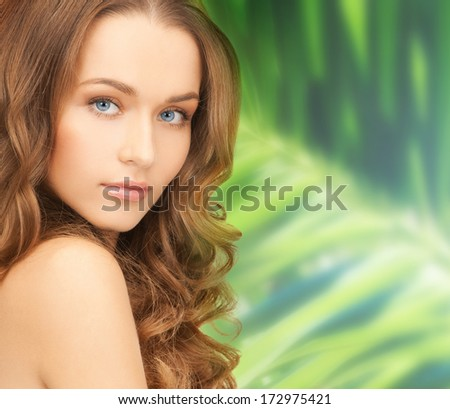 health and beauty concept - face of beautiful woman with long hair
