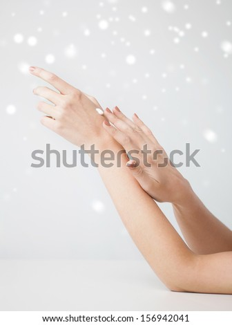 health and beauty concept - female soft skin hands with creme - stock photo