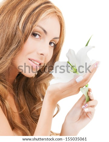 health and beauty concept - lovely woman with white lily flower