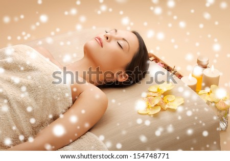 health and beauty concept - woman in spa salon lying on the massage desk - stock photo