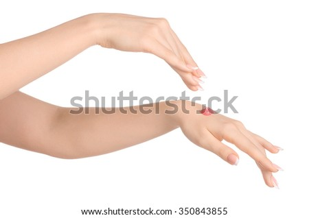 Health and body care theme: beautiful female hand with pink scrub cream on a white background isolated - stock photo