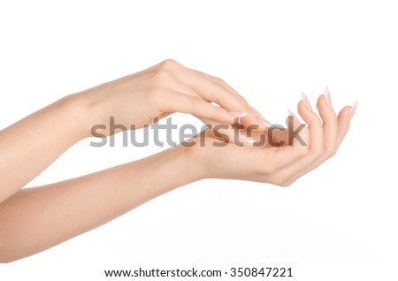 Health and body care theme: beautiful female hand with white cream isolated on a white background, hand massage - stock photo