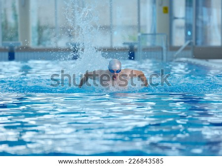 health and fitness lifestyle concept with young athlete swimmer recreating  on indoor olympic pool