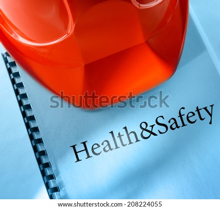 Health and safety with red helmet - stock photo