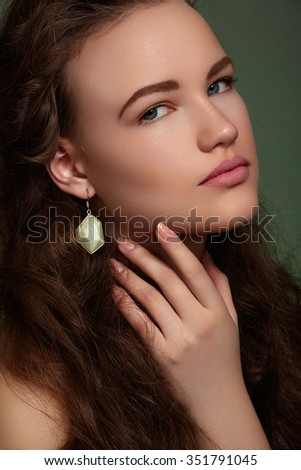Health, beauty, wellness, haircare, cosmetics and make-up. Beautiful fashion hairstyle. Woman model with shiny volume long hair and evening make-up  - stock photo