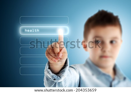 Health. Boy pressing a virtual touch screen. Blue background. - stock photo