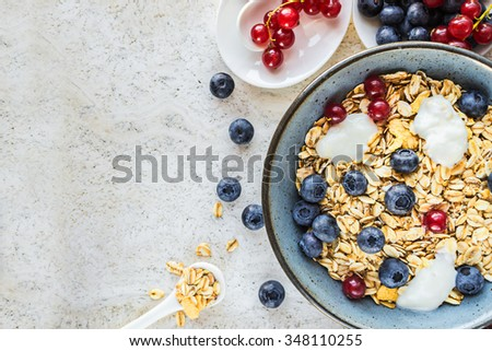 Health breakfast with  granola and fresh berries. - stock photo