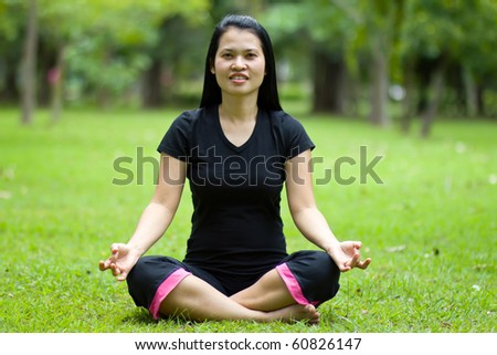 Health care concept: young woman doing yoga meditation - stock photo