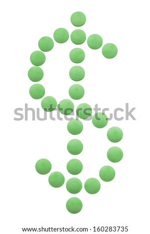 Health care costs concept - medicine pills in the shape of USA money sign - stock photo
