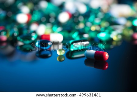 Health care, medical theme and concept. Painkillers, pills, microscope, drug development.
