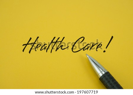 Health Care! note with pen on yellow background