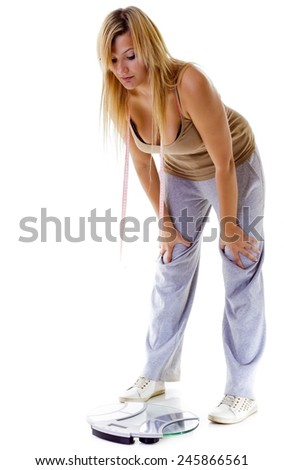 Health care overweight problem. Woman plus size large girl with scale unhappy very worried looking depressed with her weight control, studio shot isolated on white - stock photo
