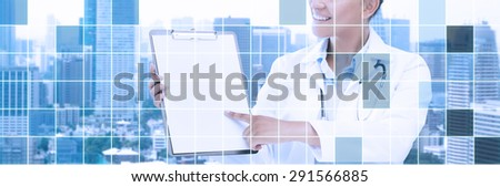 health care, people and medical concept - happy african female doctor pointing finger to blank paper on clipboard over city and blue grid background - stock photo