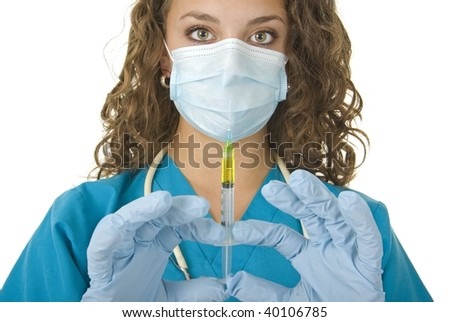 Health Care professional wearing gloves and mask preparing needle - stock photo