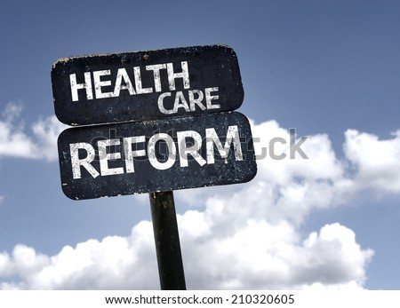 Health Care Reform sign with clouds and sky background  - stock photo
