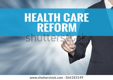 Health Care Reform word on virtual screen touch by business woman cyan sky tab - stock photo