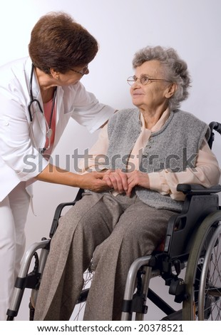 Health care worker and elderly woman in wheelchair
