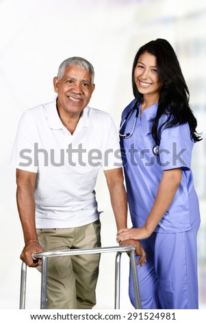 Health care worker helping an elderly man  - stock photo