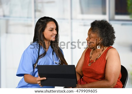 Health care worker helping an elderly woman