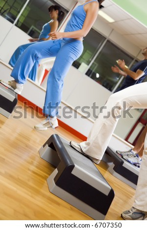 health club: group of people doing aerobics - stock photo