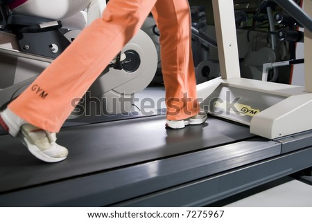 health club: woman running on a tapis roulant - stock photo