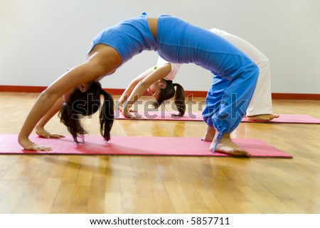 health club: women doing stretching and aerobics - stock photo