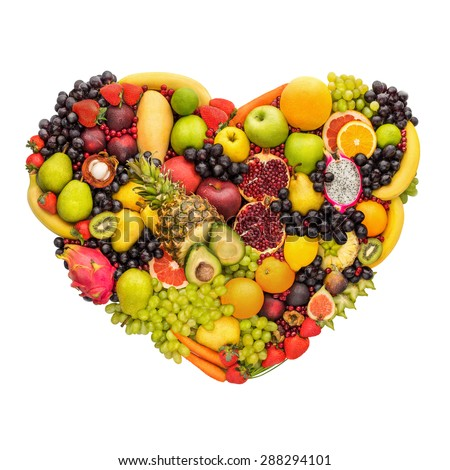 Health concept of eating smart; heart symbol made of fresh fruits that reduce death risk, isolated on white background.