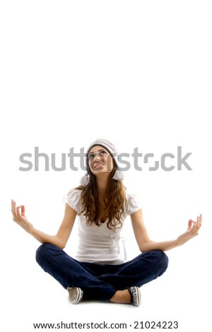 health conscious girl doing meditation against white background - stock photo