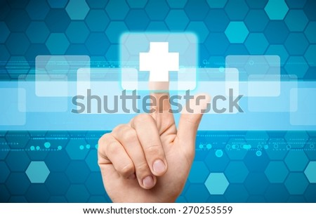 Health. Hand press on First Aid icon - stock photo