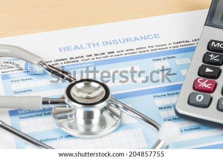 Health insurance application form with calculator and stethoscope concept for life planning - stock photo
