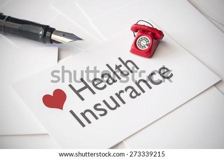Health insurance business card - stock photo