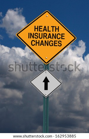 health insurance changes ahead road sign over dark sky with clouds - stock photo