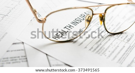 Health insurance claim form with glasses