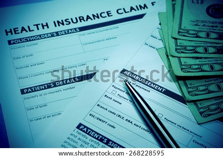 Health insurance claim form with money for health insurance concept - stock photo