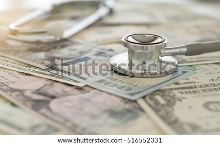 health insurance claim, stethoscope on dollar banknote money. concept of health care costs, finance, health insurance funds.