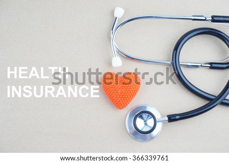 HEALTH INSURANCE concept with stethoscope and heart shape  - stock photo