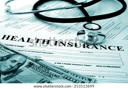 Health insurance form with dollars and stethoscope concept for life planning - stock photo