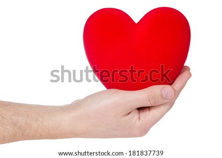 Health insurance or love concept . Heart in hand isolated on white background