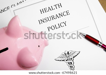 health insurance policy and piggy bank - stock photo