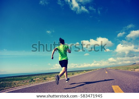health lifestyle woman trail runner running on country road