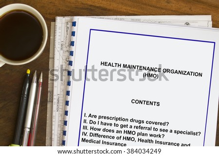 Health Maintenance Organization with coffee and documents.