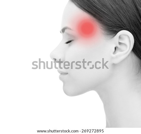 health, people and medicine concept - face of beautiful young woman suffering from headache - stock photo