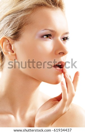 Health & skin care. Lovely woman touching her lips - stock photo